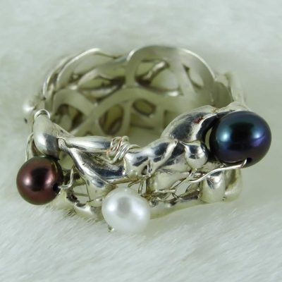 Handmade Silver Ring with Captured Pearls Photo 1