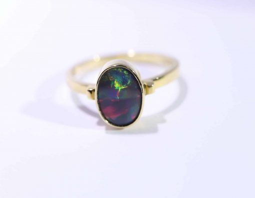 Solid opal 18ct gold ring