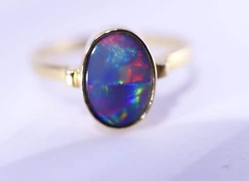 Solid 18 carat yellow gold and solid opal ring
